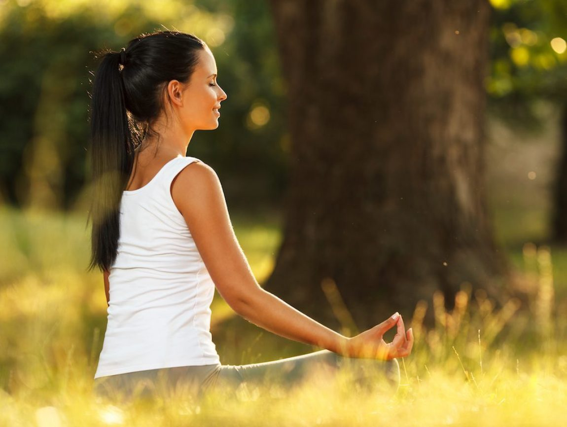 Young,Attractive,Female,Meditate,In,Nature.